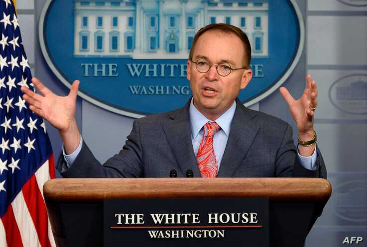 White House Acting Chief of Staff Mick Mulvaney speaks during a press briefing at the White House in Washington, DC, on October…
