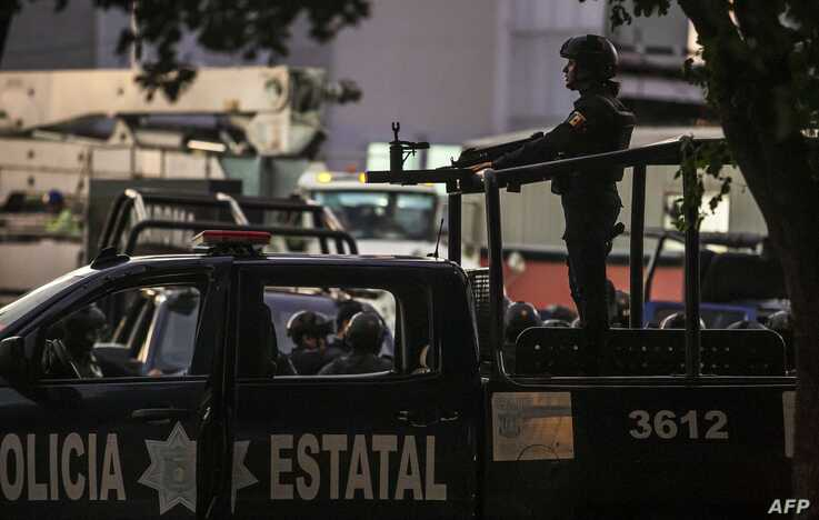 EDITORS NOTE: Graphic content / Mexican police patrol in a street of Culiacan, state of Sinaloa, Mexico, on October 17, 2019,…