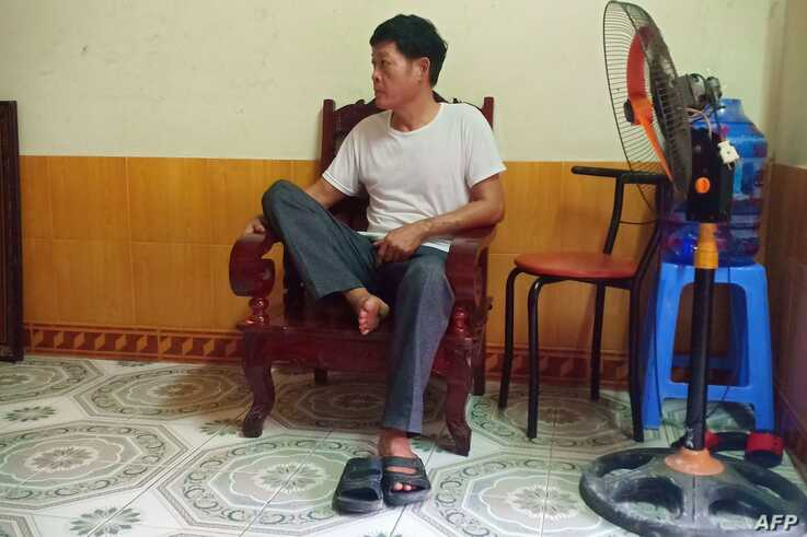 Pham Van Thin, father of 26-year-old Pham Thi Tra My who is feared to be among the 39 people found dead in a truck in Britain,…