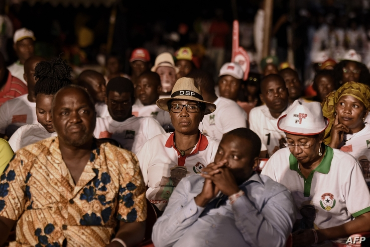 Supporters of presidential candidate Domingos Simoes Pereira (DSP) from the traditional ruling African Party for the…