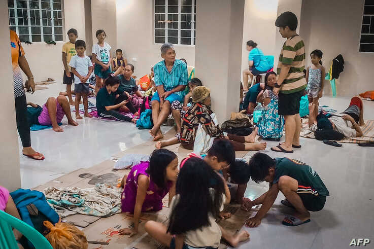 Residents rest in an evacuation centre, as typhoon Phanfone makes landfall, in Borongan, Eastern Samar province, central…
