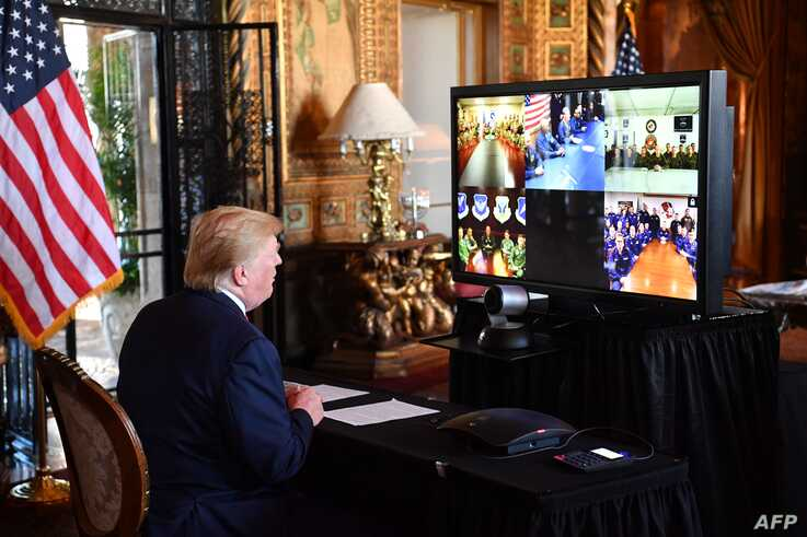 US President Donald Trump makes a video call to the troops stationed worldwide at the Mar-a-Lago estate in Palm Beach…