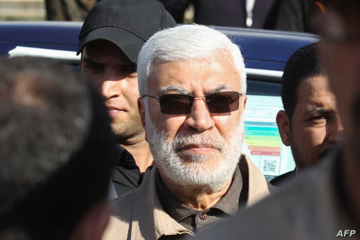 (FILES) This file photo taken on December 31, 2019 shows Abu Mahdi al-Muhandis, a commander in the Popular Mobilization Forces,…