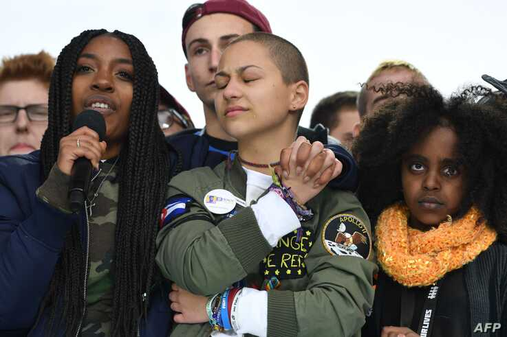 (FILES) In this file photo taken on March 24, 2018 Marjory Stoneman Douglas High School student Emma Gonzalez(C) listens with…