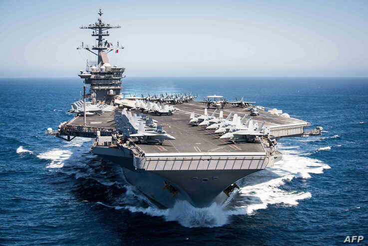 (FILES) This US Navy file handout photo shows the aircraft carrier USS Theodore Roosevelt (CVN 71)as it transits the Pacific…