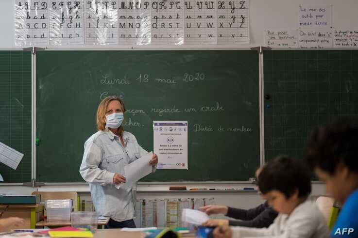 A teacher gives a lesson at the Cour de Lorraine elementary school in Mulhouse, eastern France, on its re-opening day for…