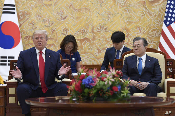 President Donald Trump, left, speaks as he sits with South Korean President Moon Jae-in, right, during a bilateral meeting at the Blue House in Seoul, Sunday, June 30, 2019.