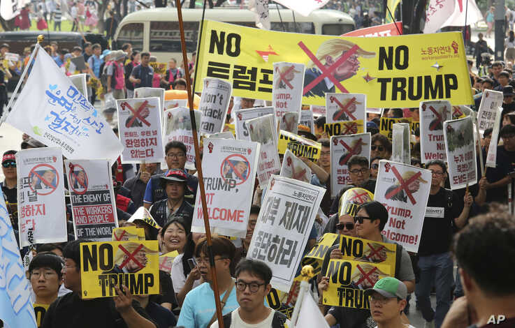 Protesters march after a rally to oppose a planned visit by the U.S. President Donald Trump in Seoul, South Korea, Saturday, June 29, 2019. North Korea said Saturday President Donald Trump's offer to meet leader Kim Jong Un at the Korean…