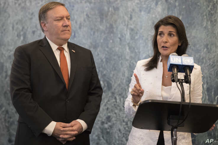 "FILE - In this Friday, July 20, 2018 file photo, U. S. Secretary of State Mike Pompeo, left, and American Ambassador to the United Nations Nikki Haley speak to reporters at United Nations headquarters. The United States has called an urgent meeting of the U.N. Security Council for Monday, Sept. 17, 2018 in response to what it says are efforts by some countries ""to undermine and obstruct"" sanctions against North Korea. (AP Photo/Mary Altaffer, File)"