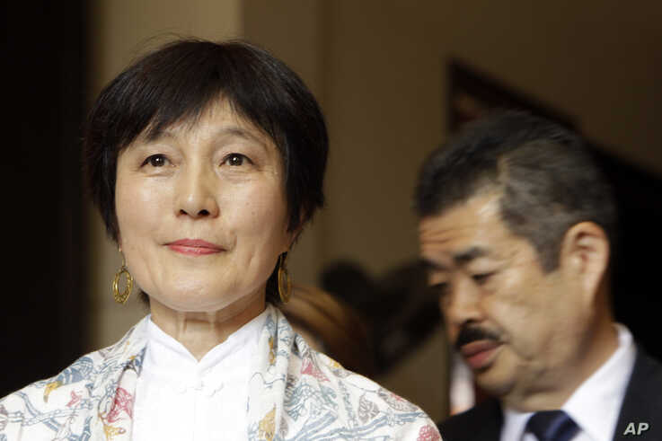 Japanese collector Fumiko Takakuwa, left, attends the handover ceremony at the National Museum, in Phnom Penh, Cambodia, July 5, 2019.