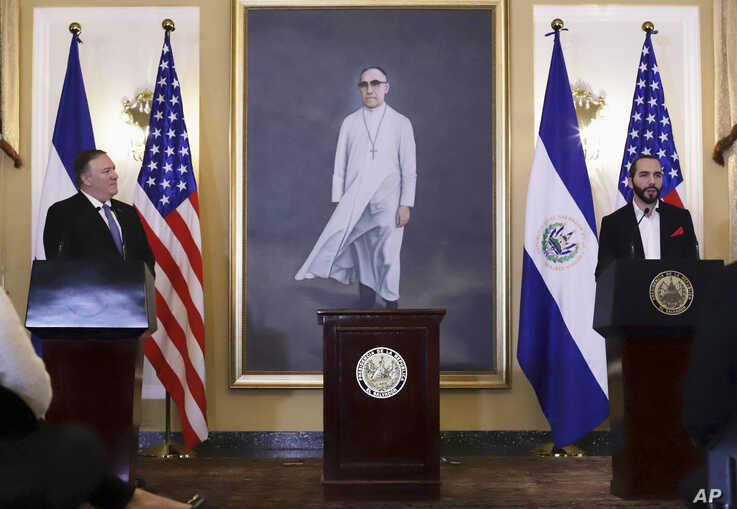 U.S. Secretary of State Mike Pompeo, left, listens to simultaneous translation as El Salvador's President Nayib Bukele speaks at the Presidential House in San Salvador, El Salvador, Sunday, July 21, 2019. Pompeo ends his Latin American tour in this…