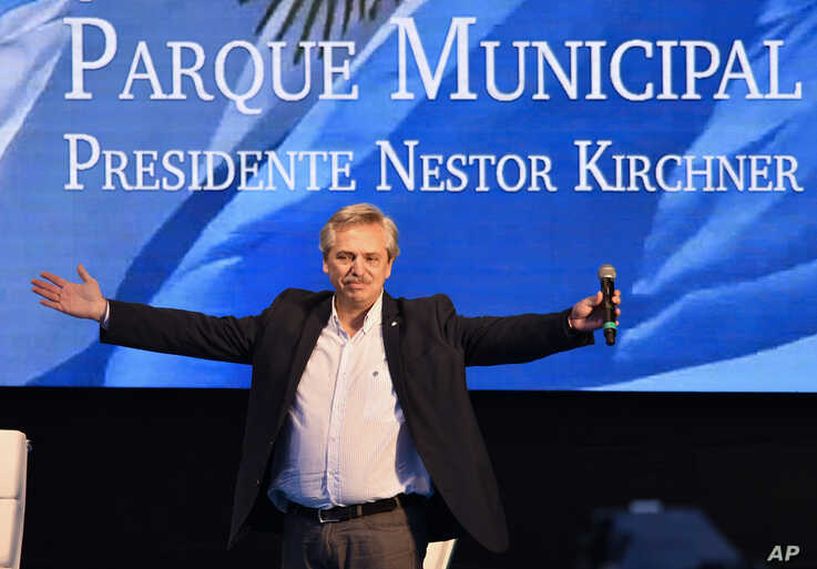FILE - In this May 25, 2019 file photo, Argentine presidential candidate Alberto Fernandez acknowledges the audience during a campaign rally in Buenos Aires, Argentina. On Monday, June 3, 2019, Fernandez checked himself into the hospital for tests…