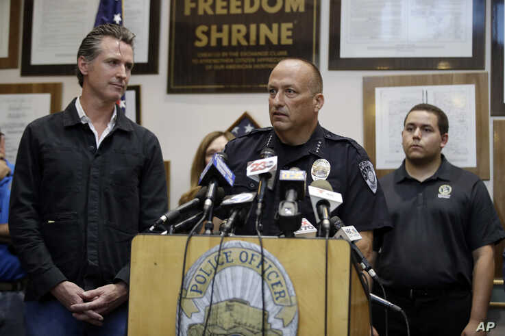 Ridgecrest Police Chief Jed McLaughlin, right, speaks as California Gov. Gavin Newsom listens, July 6, 2019, in Ridgecrest, Calif. Crews in Southern California assessed damage Saturday after a 7.1 magnitude quake jolted an area from Sacramento to Mexico.