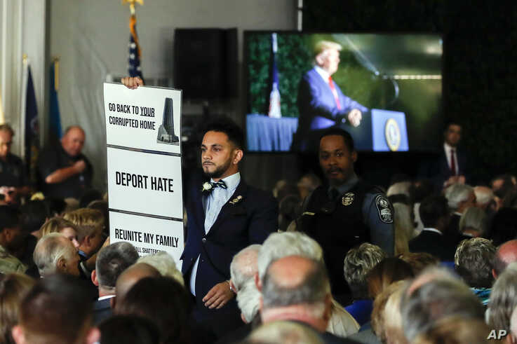 Virginia Del. Ibraheem Samirah, D-Fairfax, is escorted out after interrupting President Donald Trump as he spoke at an event marking the 400th anniversary of the first representative assembly, July 29, 2019, in Jamestown, Va.