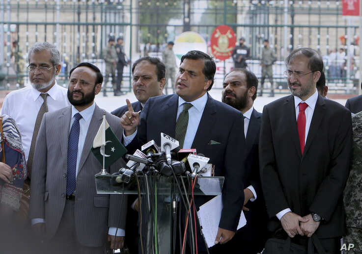 Pakistan Foreign Ministry spokesman Mohammad Faisal, center, briefs the media before the meeting with Indian officials at Wagah border, near Lahore, Pakistan, Sunday, July 14, 2019. Pakistani and Indian officials met at Wahga joint border point for…