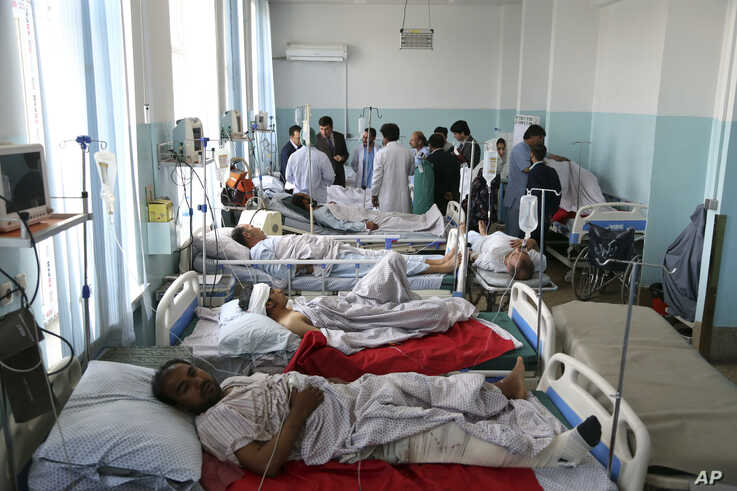 Wounded people receive treatment in a hospital after a powerful bomb blast in Kabul, Afghanistan, Monday, July 1, 2019. A powerful bomb blast rocked the Afghan capital early Monday, rattling windows, sending smoke billowing from Kabul's downtown…