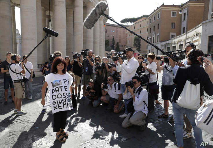 "A demonstrator wears a shirt with writing in Italian reading ""Please give the justice dossier for Emanuela"" on the outskirts of the Vatican, in Rome, Thursday, July 11, 2019. The Vatican will reopen a tomb near St. Peter's Basilica after further…"