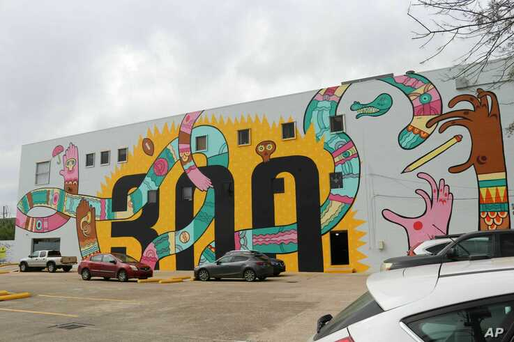 This mural celebrating New Orleans' tricentennial is among nearly two dozen created through Neal Morris's NOLA Murals Project after Morris sued New Orleans to overturn its murals regulations. A federal judge has scheduled a hearing for Tuesday, July…