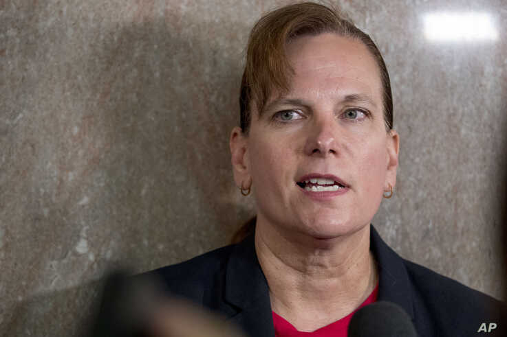 Former aide, Army Col. Kathryn Spletstoser, who has accused that Air Force Gen. John Hyten subjected her to a series of unwanted sexual advances, speaks to the media following Hyten's confirmation hearing.
