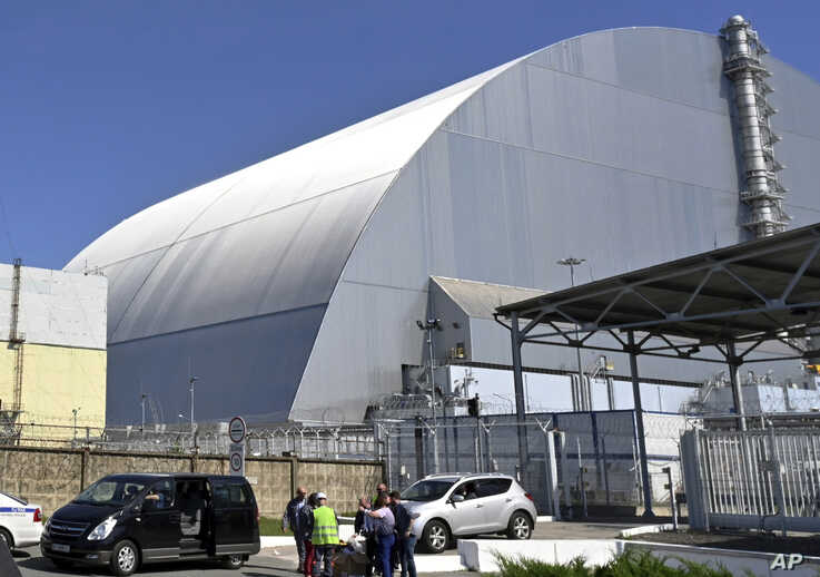 FILE - This June 1, 2019, file photo shows a view of the New Safe Confinement (NSC) movable enclosure at the nuclear power plant in Chernobyl, Ukraine. A new structure built to confine the Chernobyl nuclear reactor at the center of the world's worst…