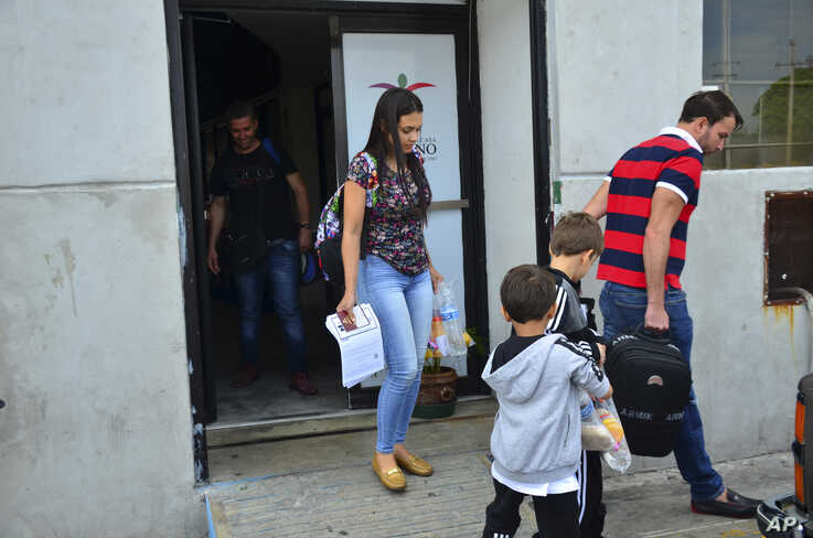 Lucia Ascencio of Venezuela, her husband and their two sons, arrive back to Nuevo Laredo, Mexico, as part of the first group of migrants to be returned to Tamaulipas state as part of a program for U.S. asylum-seekers, July 9, 2019.