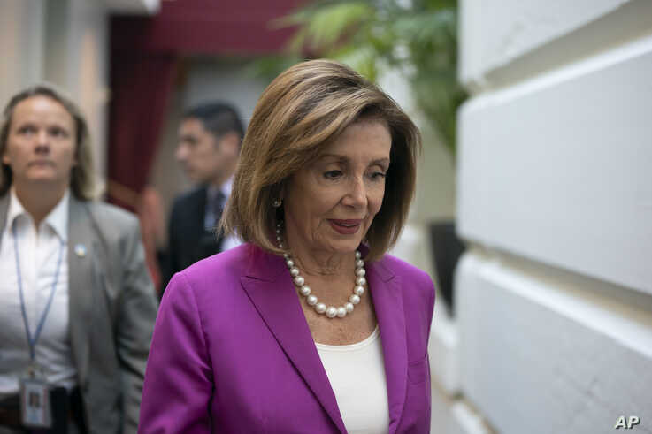 """House Speaker Nancy Pelosi, D-Calif., arrives for a closed-door session with her caucus before a vote on a resolution condemning what she called """"racist comments"""" by President Donald Trump at the Capitol in Washington, Tuesday, July 16, 2019. His…"""