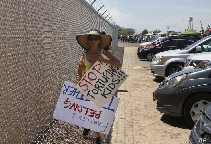 "A grandmother protesting the treatment of children in Border Patrol custody walks back to her car by a fence at a holding center in Clint, Texas, July 1, 2019. Yvonne Nieves, in her 50s, says she has a 2-year-old granddaughter. ""I just couldn't bear…"