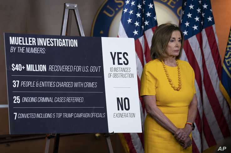 Speaker of the House Nancy Pelosi, stands beside a chart during a newss conference following the back-to-back hearings with former special counsel Robert Mueller who testified about his investigation into Russian interference in the 2016 election, on Capitol Hill in Washington, July 24, 2019.