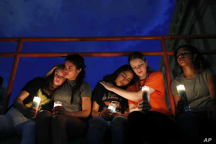 From left, Melody Stout, Hannah Payan, Aaliyah Alba, Sherie Gramlich and Laura Barrios comfort each other during a vigil for victims of the shooting Saturday, Aug. 3, 2019, in El Paso, Texas. A young gunman opened fire in an El Paso, Texas, shopping…