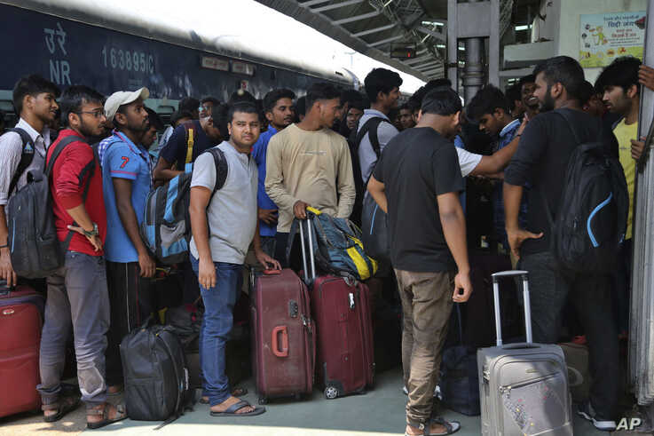 National Institute of Technology (NIT) students who left Srinagar, Kashmir's main city wait to leave for their respective homes at the railway station in Jammu, India, Aug. 4, 2019.