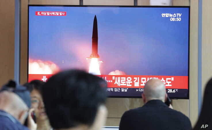 People watch a TV showing a file image of a North Korea's missile launch during a news program at the Seoul Railway Station in Seoul, South Korea, Tuesday, Aug. 6, 2019. North Korea on Tuesday continued to ramp up its weapons demonstrations by…