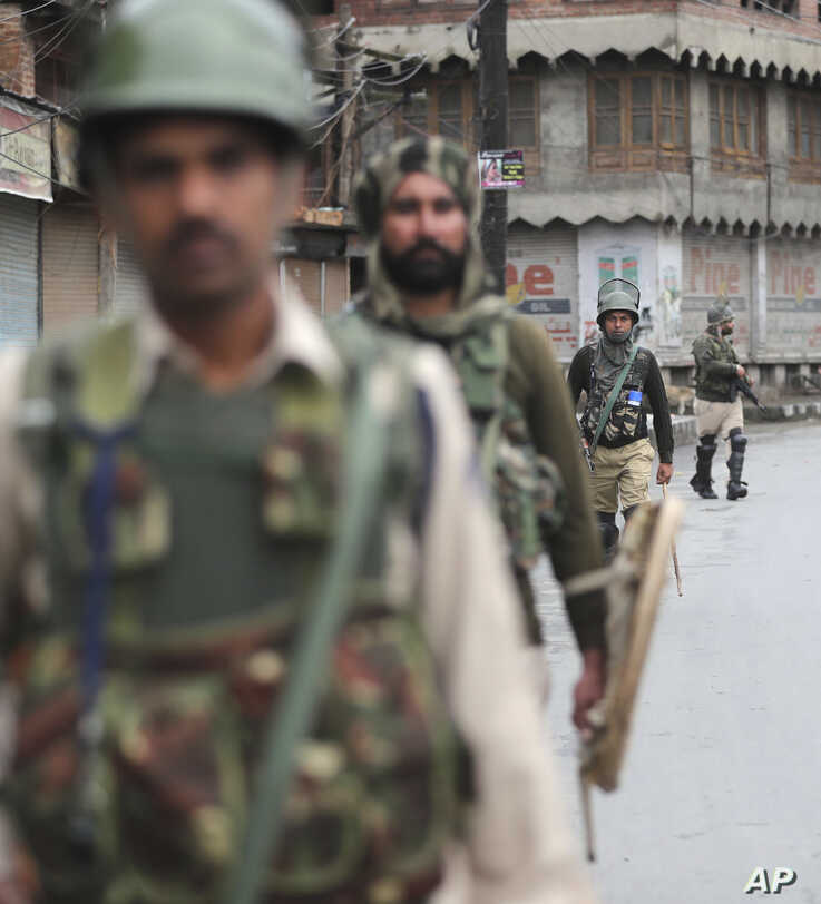 Indian paramilitary soldiers patrol a street in Srinagar, Indian-controlled Kashmir, Aug. 10, 2019. Authorities enforcing a strict curfew in Indian-administered Kashmir will bring in trucks of essential supplies for an Islamic festival next week.
