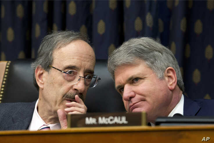 FILE - In this Feb. 13, 2019 file photo, House Foreign Affairs Committee Chairman Rep. Eliot Engel D-N.Y., left, speaks with Ranking member Rep. Michael McCaul, R-Texas during the House Foreign Affairs subcommittee hearing in Washington. The House…