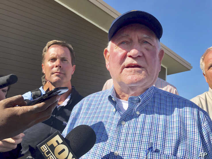 U.S. Agriculture Secretary Sonny Perdue speaks to reporters at an Ag Policy Summit during a visit Wednesday, Aug. 28, 2019 to Decatur, Ill. Perdue has sought to assuage farmers' fears of financial problems after China halted purchases of U.S. farm…
