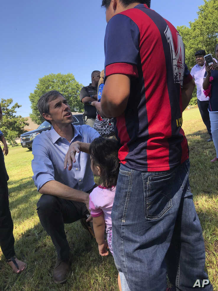 Presidential candidate Beto O'Rourke speaks in Spanish to Guatemalan immigrant Agusto Lopez Coronado in Canton, Miss., Aug. 16, 2019. Coronado initially declined to give his name to journalists because he fears  after the immigration raids at chicken processing plants in Mississippi.