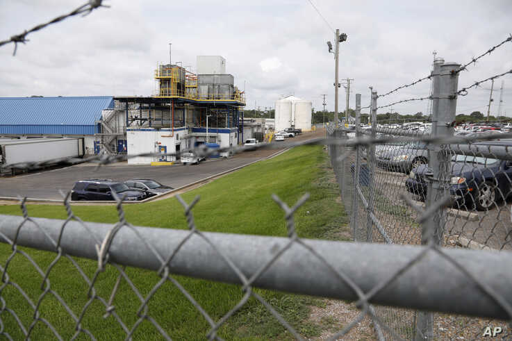 Business continues at this Koch Foods Inc., plant in Morton, Miss.,, Aug. 8, 2019, following Wednesday's raid by U.S. immigration officials. More than 300 of the 680 people arrested have been released from custody.