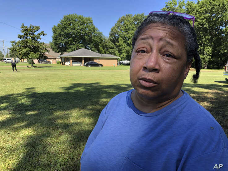 "Giwada ""Gi Gi"" Williams, a resident of Canton, Miss., waits to see Democratic presidential candidate Beto O'Rourke, Aug. 16, 2019, in Canton, Miss. Williams said she is concerned about people who were caught up in immigration raids at Mississippi chicken processing plants."