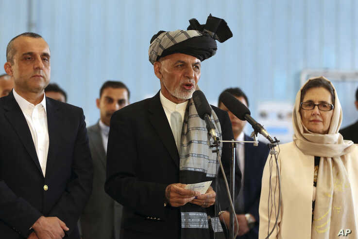 Afghan President Ashraf Ghani, center, speaks to journalists after voting at Amani high school, near the presidential palace in Kabul, Afghanistan, Saturday, Sept. 28, 2019. Afghans headed to the polls on Saturday to elect a new president amid high…