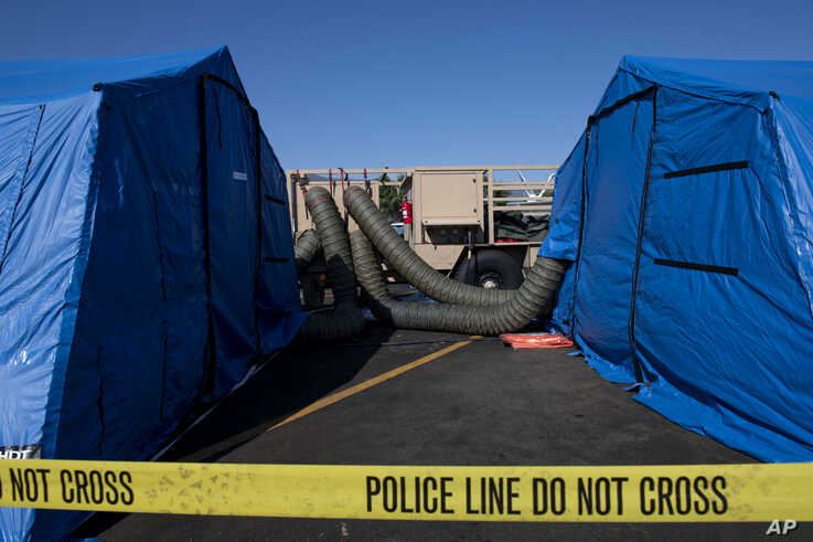 """Large generators push air through tubes into tents being used by investigators to examine evidence from the """"Conception"""" at the Santa Barbara Harbor on Wednesday, Sept. 4, 2019 in Santa Barbara, Calif. A fire raged through a boat carrying…"""