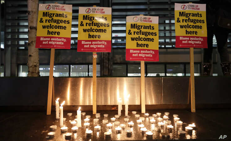 Signs and candles on a wall were placed at a vigil for the 39 lorry victims, outside the Home Office in London, Thursday, Oct…