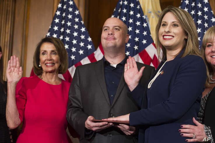 House Speaker Nancy Pelosi of Calif., right, poses during a ceremonial swearing-in with Rep. Katie Hill, D-Calif., on Capitol…