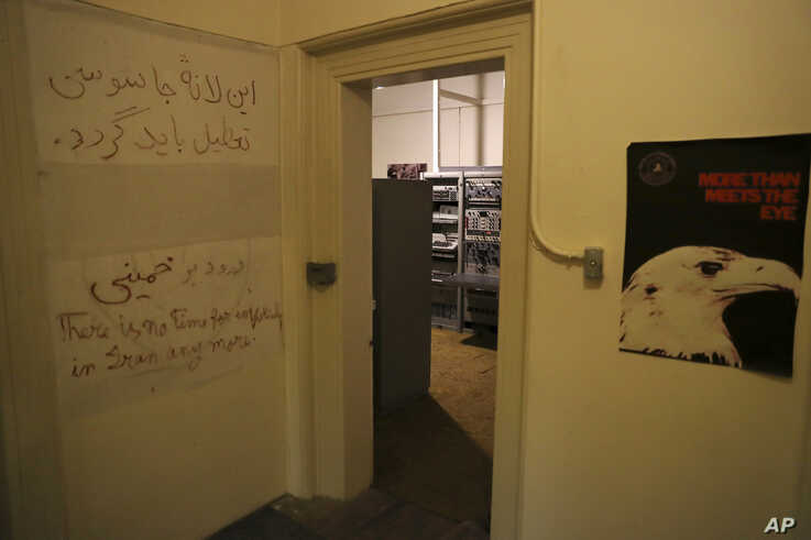 In this Sept. 26, 2019 photo, anti-U.S. slogans are written on the wall of a corridor of the former U.S. Embassy, now partly a…