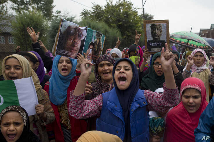 Kashmiris shout slogans during a protest after Friday prayers against the abrogation of article 370, on the outskirts of…
