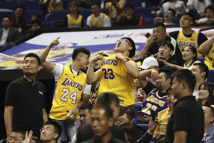 Chinese fans react during a preseason NBA basketball game between the Brooklyn Nets and Los Angeles Lakers at the Mercedes Benz…