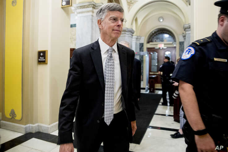 Former Ambassador William Taylor leaves a closed door meeting after testifying as part of the House impeachment inquiry into…