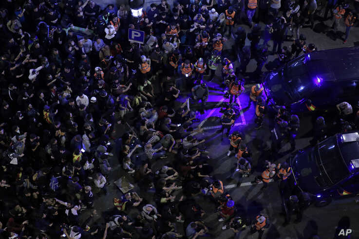 Catalan pro-independence demonstrators pack the street in Barcelona, Spain, Saturday, Oct. 19, 2019. Barcelona and the rest of…