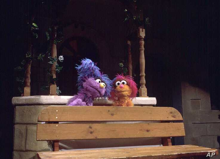 File - In this April 1, 1997 file photo, Israeli muppet Daffy, left, visits Palestinian muppet Haneen on the set of a…
