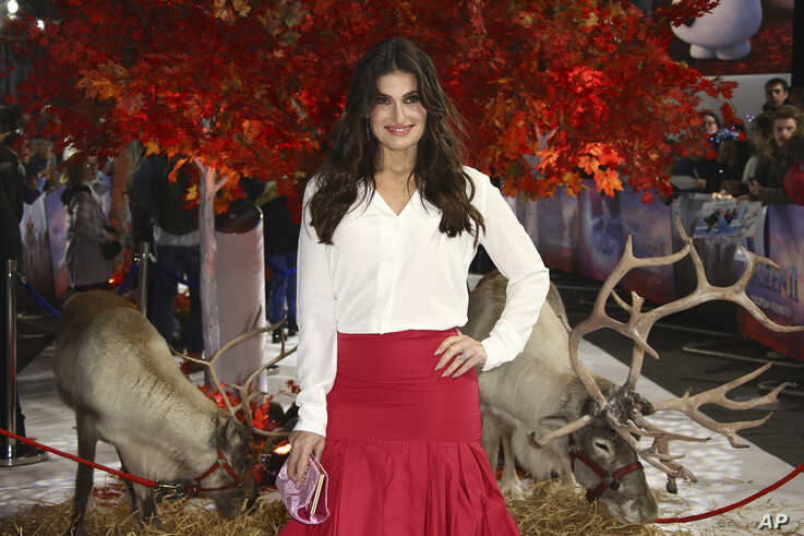 Voice actress Idina Menzel, poses for photographers alongside reindeer, upon arrival at the European premiere of 'Frozen 2', in…