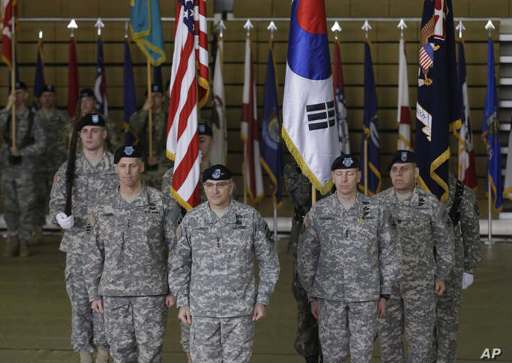 Incoming Commander General of the Eighth U.S. Army, Lt. Gen. Thomas S. Vandal, second from left, ROK-US Combined Forces Command…