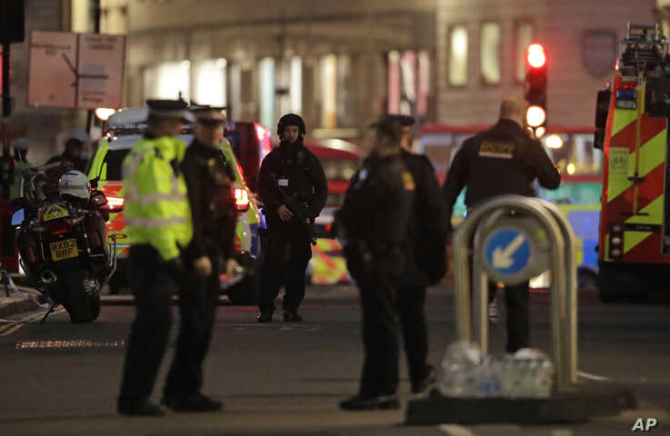 Armed police officers on the north side of London Bridge in London, Friday, Nov. 29, 2019. British police shot a man on London…